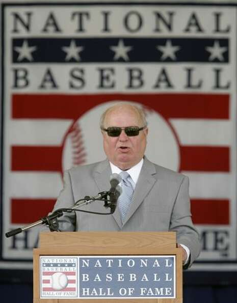 Dave Niehaus delivers his induction speech at the Baseball Hall of Fame in Cooperstown, July 27, 200
