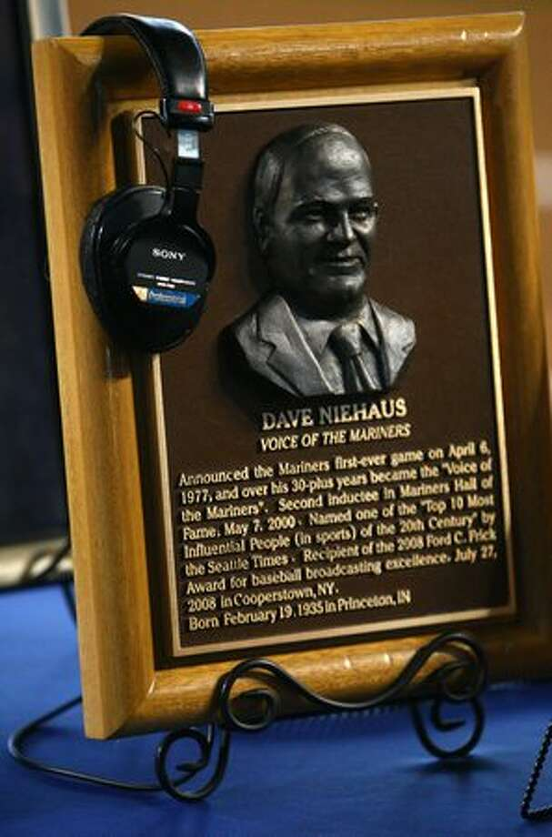 Dave Niehaus' headset rests on a plaque during a Nov. 13, 2010 tribute to him at Safeco Field in Seattle. (Joshua Trujillo, Seattlepi.com) Photo: P-I File