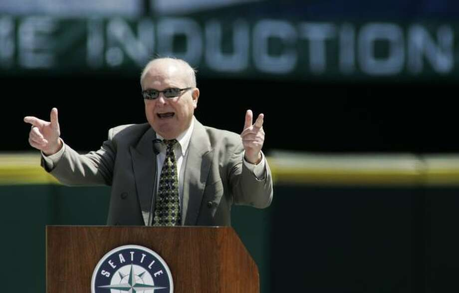 Dave Niehaus, the voice of the Seattle Mariners, salutes former designated hitter Edgar Martinez, June 1, 2007, at a Safeco Field luncheon. (Ted S. Warren/The Associated Press/seattlepi.com file) Photo: P-I File