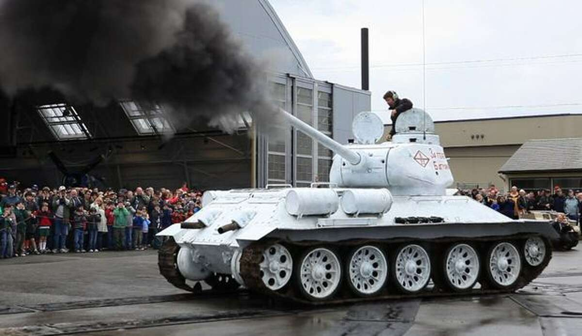 A Soviet T-34 tank is fired at the Flying Heritage Collection at Paine Filed in Everett on Monday, May 31, 2010. A large crowd gathered for the Memorial Day unveiling of the Soviet T-34 tank and a Jagdpanzer 38(t). The fully-operational vehicles were driven in front an audience of enthusiasts and the guns on the vehicles were each fired once.