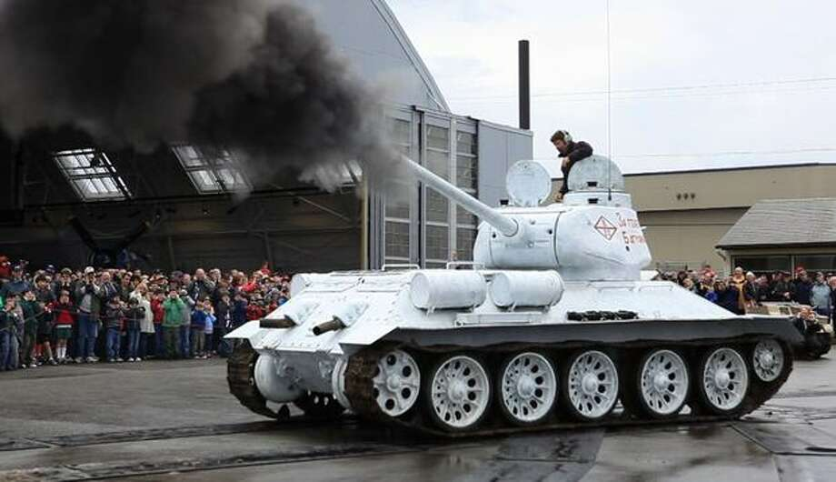 A Soviet T-34 tank is fired at the Flying Heritage Collection at Paine Filed in Everett on Monday, May 31, 2010. A large crowd gathered for the Memorial Day unveiling of the Soviet T-34 tank and a Jagdpanzer 38(t). The fully-operational vehicles were driven in front an audience of enthusiasts and the guns on the vehicles were each fired once. Photo: Joshua Trujillo, Seattlepi.com
