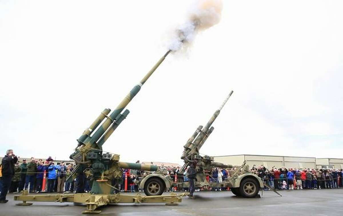 A pair of FlaK 88mm anti-aircraft guns are fired at the Flying Heritage Collection.