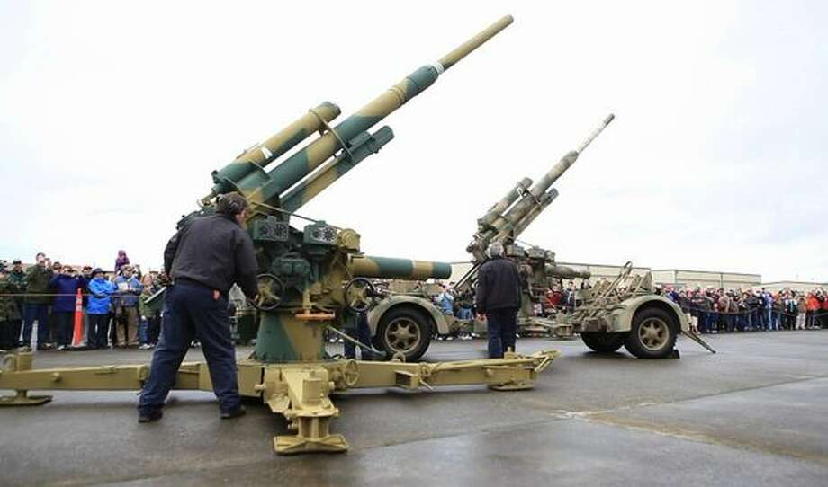 A pair of FlaK 88mm anti-aircraft guns are raised before firing at the Flying Heritage Collection. Photo: Joshua Trujillo, Seattlepi.com