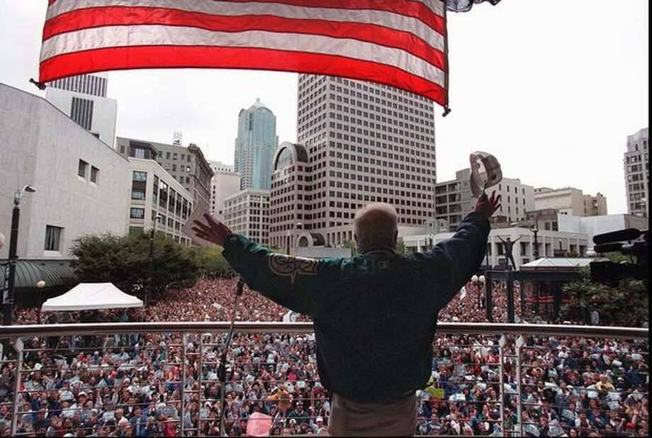 Mariner's radio man Dave Niehaus waves to a sea of people at a Mariner's rally outside Westlake Center, Oct. 11, 1995. (Robin Layton/seattlepi.,com file) Photo: P-I File
