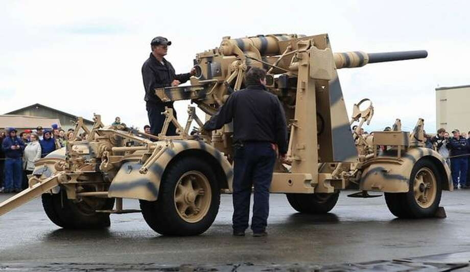 A FlaK 88mm anti-tank gun is aimed before firing at the Flying Heritage Collection. Photo: Joshua Trujillo, Seattlepi.com