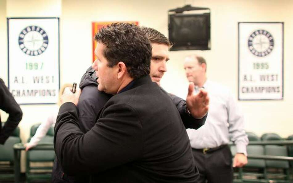 Former Seattle Mariner stars Dan Wilson and Edgar Martinez embrace on Thursday, November 11, 2010 at