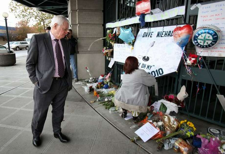 Seattle Mariner President and COO Chuck Armstrong looks over a growing memorial to longtime Mariner broadcaster Dave Niehaus at the gates of Safeco Filed on Thursday, November 11, 2010. Niehaus died of a heart attack on Wednesday. (Joshua Trujillo, Seattlepi.com) Photo: P-I File