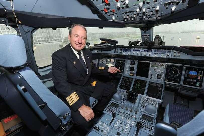 Lufthansa Pilot Juergen Raps Poses In The Cockpit Of His