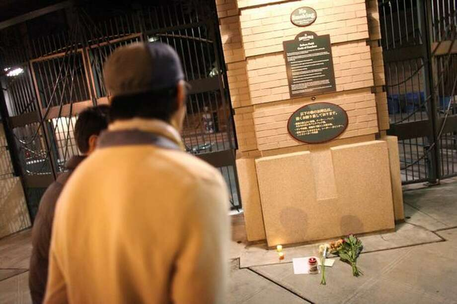 Fans gather at the gates of Safeco Field on Wednesday, November 10, 2010 after the death of longtime Seattle Mariners broadcaster Dave Niehaus. (Joshua Trujillo, Seattlepi.com). Photo: P-I File