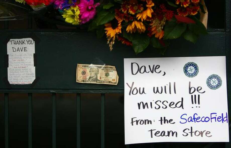 A $10 bill was among the items left at a growing memorial to longtime Mariner broadcaster Dave Niehaus at the gates of Safeco Filed on Thursday, November 11, 2010. Niehaus died of a heart attack on Wednesday. (Joshua Trujillo, Seattlepi.com) Photo: P-I File