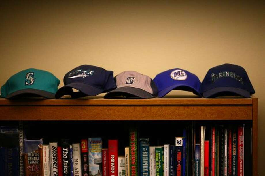 An assortment of Mariners baseball caps are shown inside the booth of Mariners broadcaster Dave Niehaus on Wednesday, November 10, 2010. (Joshua Trujillo, Seattlepi.com). Photo: P-I File