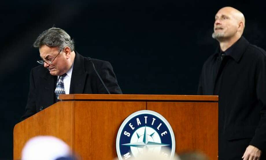 Rick Rizzs tries to hold back his emotion as former Mariner Jay Buhner takes the stage to offer comfort to Rizzs during a celebration of life ceremony for Seattle Mariners broadcaster Dave Niehaus on Saturday, December 11, 2010 at Safeco Field. The longtime voice of the Mariners passed away last month. (Joshua Trujillo, Seattlepi.com) Photo: P-I File