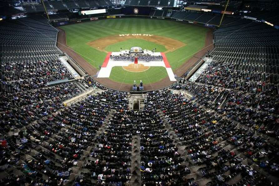 People gather during a celebration of life ceremony for Seattle Mariners broadcaster Dave Niehaus on