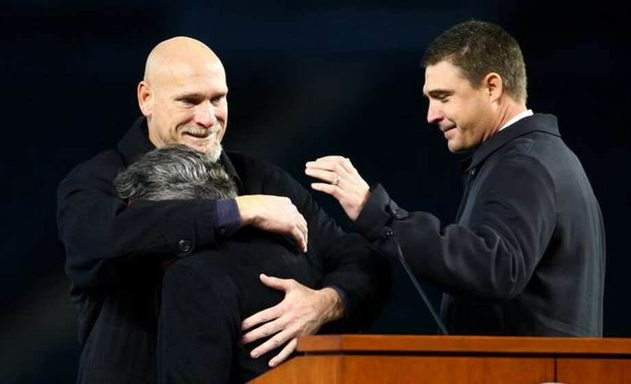 Jay Buhner, left, and Dan Wilson comfort Rick Rizzs during a celebration of life ceremony for Seattle Mariners broadcaster Dave Niehaus on Saturday, December 11, 2010 at Safeco Field. The longtime voice of the Mariners passed away last month. (Joshua Trujillo, Seattlepi.com)... Photo: P-I File