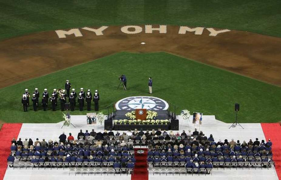 A U.S. Navy band performs the national anthem during a celebration of life ceremony for Seattle Mari