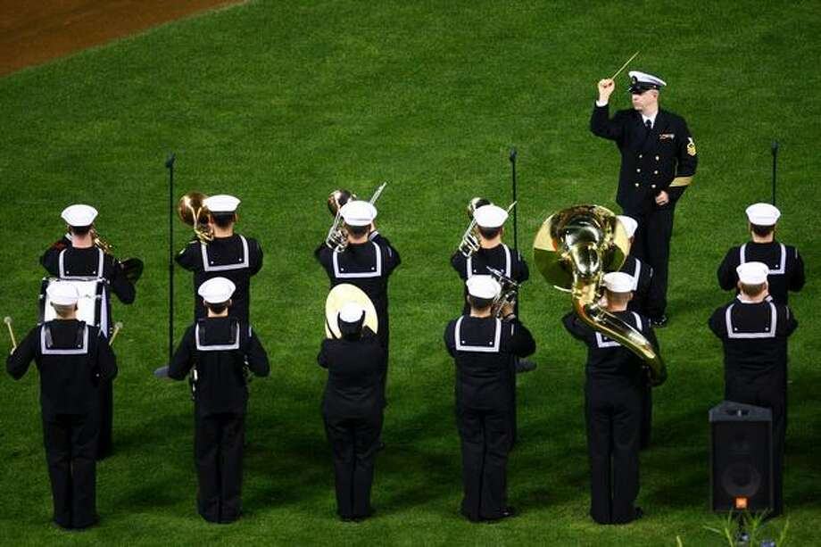 A U.S. Navy band performs the national anthem during a celebration of life ceremony for Seattle Mariners broadcaster Dave Niehaus on Saturday, December 11, 2010 at Safeco Field. The longtime voice of the Mariners passed away last month. (Joshua Trujillo, Seattlepi.com). Photo: P-I File