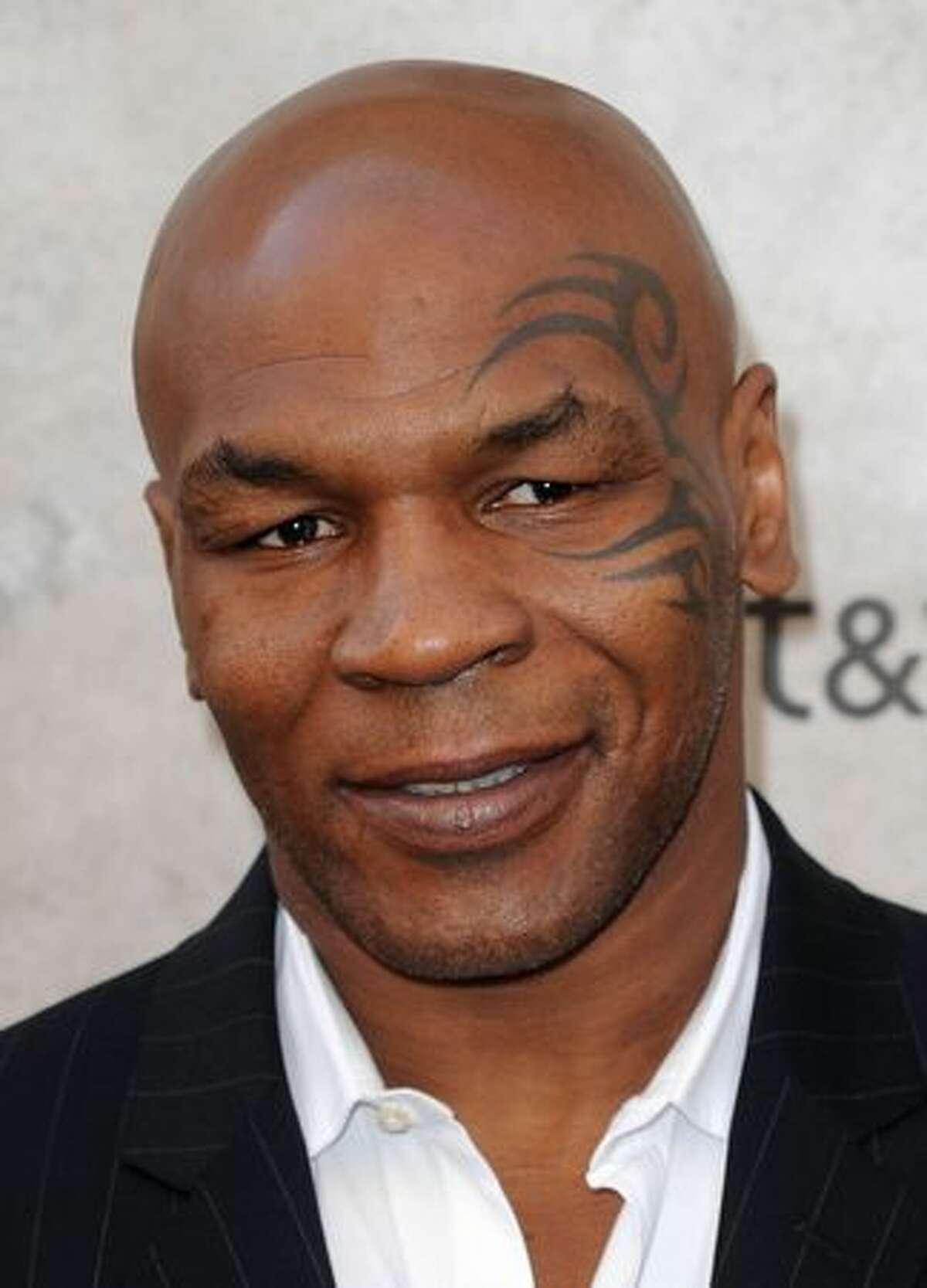 Boxer Mike Tyson arrives.