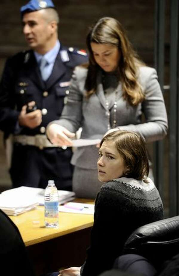Amanda Knox (right) sits in court before the start of the second hearing of her appeal trial. Photo: Getty Images