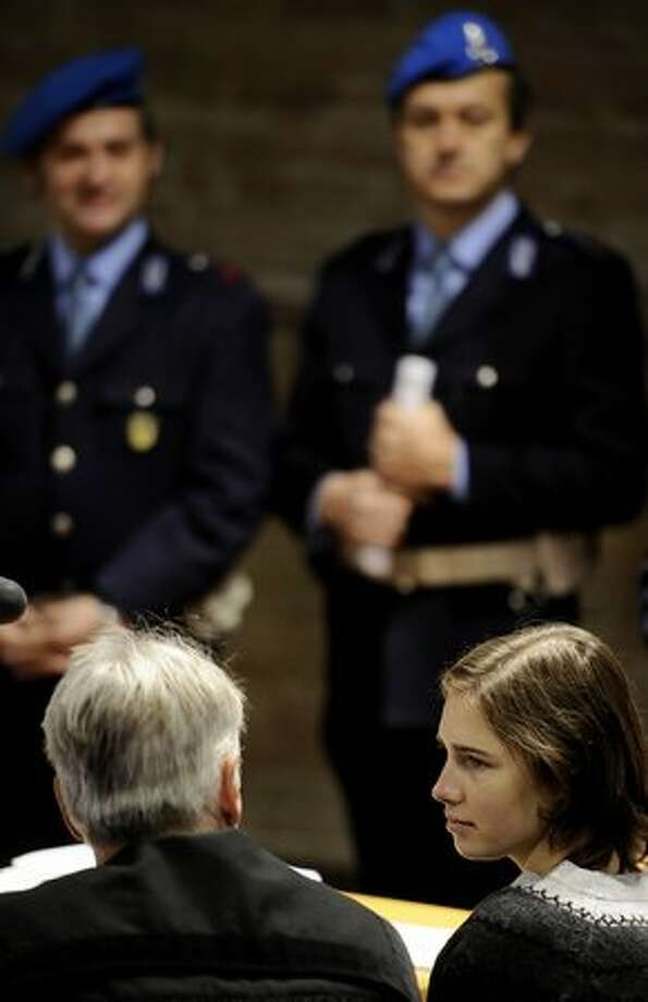 Amanda Knox listens to her lawyer prior to the hearing. Photo: Getty Images
