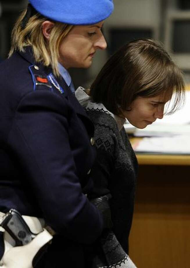 Amanda Knox is escorted by police. Photo: Getty Images