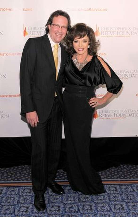 "Alexis would be proud. Former ""Dynasty"" star Joan Collins, 77, and husband Percy Gibson, 45, a gala in New York on Nov. 17, 2010. The couple renewed their vows last year. Photo: Getty Images"