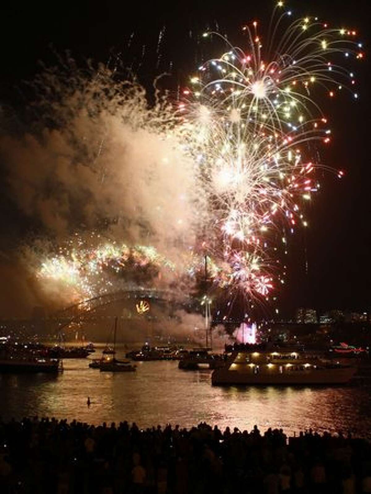 Fireworks erupt over the Sydney Harbour bridge during New Year's in Sydney on January 1, 2011.