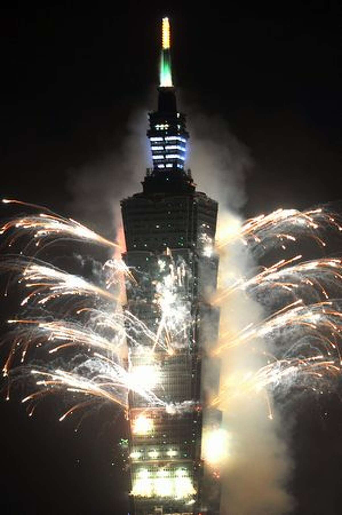 Fireworks explode above Taiwan's tallest building, Taipei 101, on January 1, 2011 to celebrate the New Year. Hundreds of thousands of people gathered in Taipei to mark the 100th anniversary of the establishment of the Republic of China.