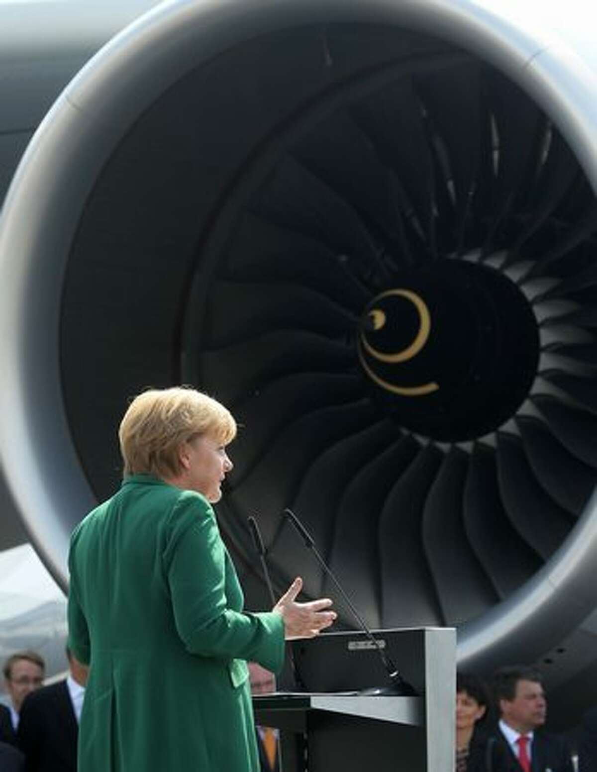 German Chancellor Angela Merkel speaks in front of a Lufthansa Airbus A380 airliner at the ILA Berlin Air Show.