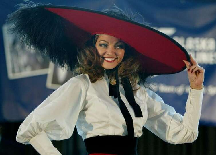 An Alaska Airline Flight Attendant Models A Uniform From