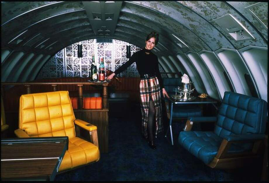 A United Airlines flight attendant poses in the upper deck of a Boeing 747 in this 1970s publicity shot. Photo: Museum Of Flight