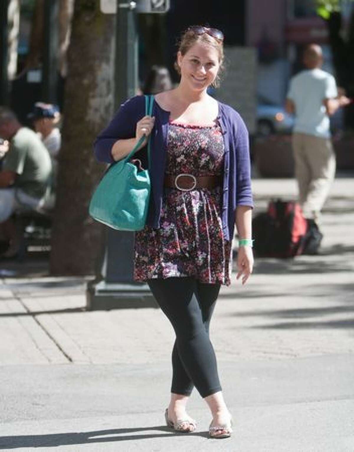 Rebekah Hess mixes it up with her layered look dressing her summer dress with a purple sweater. She completes her sassy summer look with a complimenting turquoise bag and silver slip-ons.