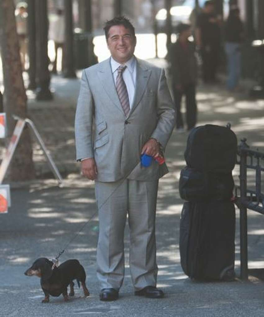 Matthew Bergman confidently strode through Pioneer Square, casually sporting his usual work suit accompanied by his dachshund.