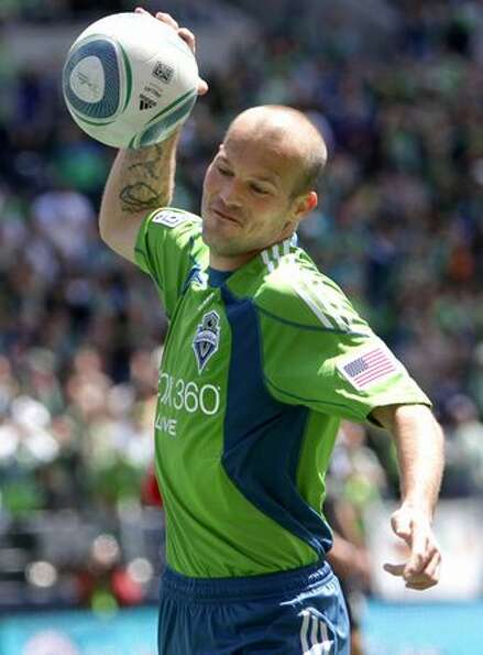 A visibly frustrated Freddie Ljungberg throws the ball to the pitch after the Sounders missed a goal