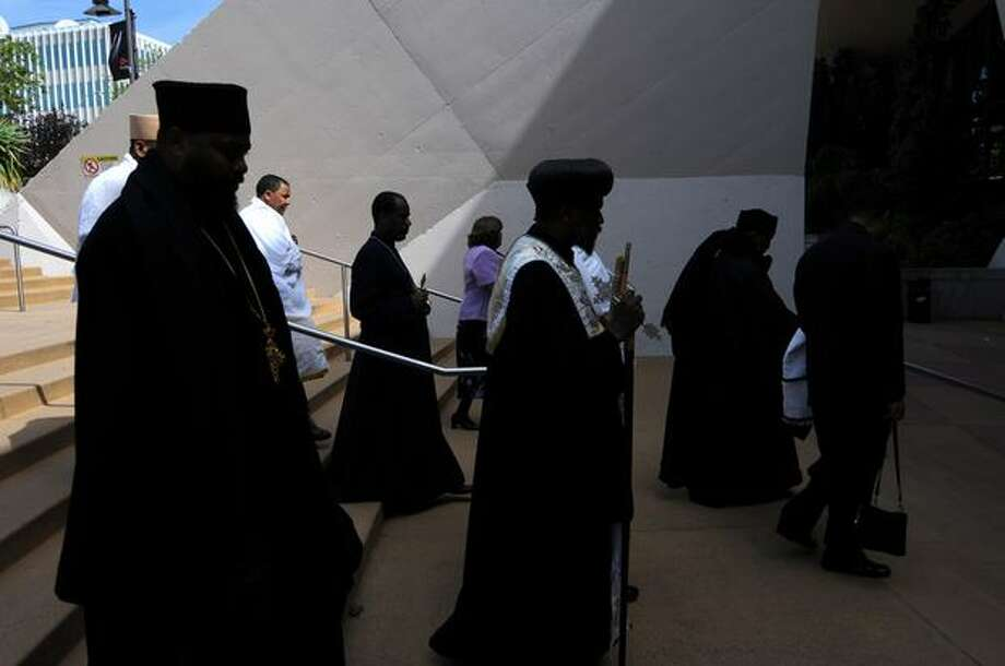 Members of the clergy and Ethiopian community enter the funeral service at KeyArena for five people killed in an apartment fire in Fremont. Photo: Daniel Berman, Special To Seattlepi.com