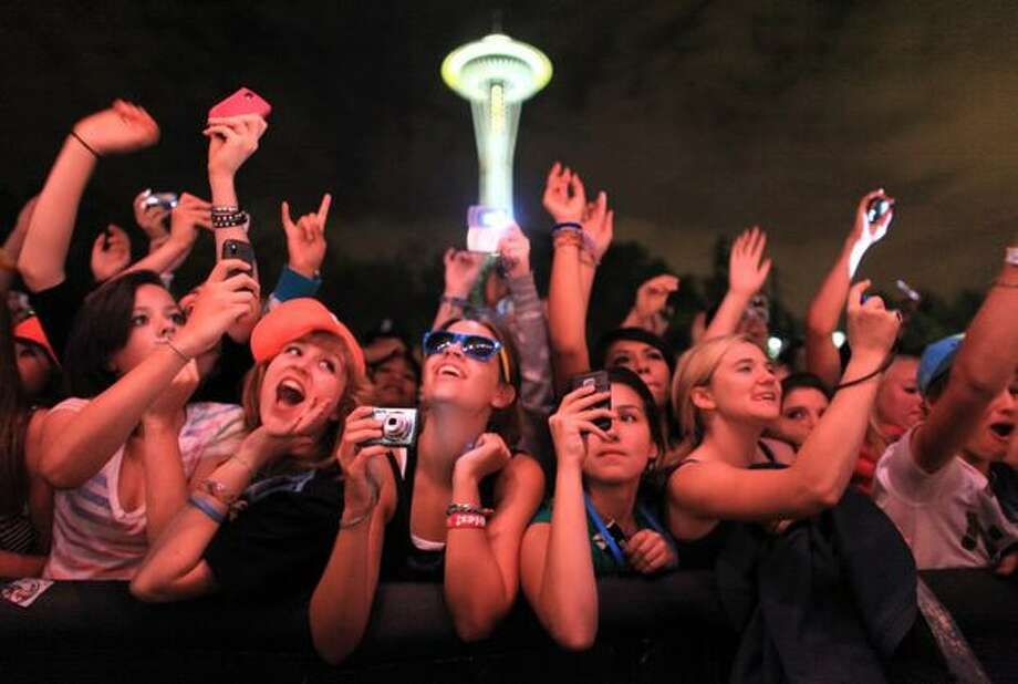 Fans cheer for LMFAO at the Fischer Green Stage during day two of the 40th annual Bumbershoot music festival at the Seattle Center. Photo: Joshua Trujillo, Seattlepi.com