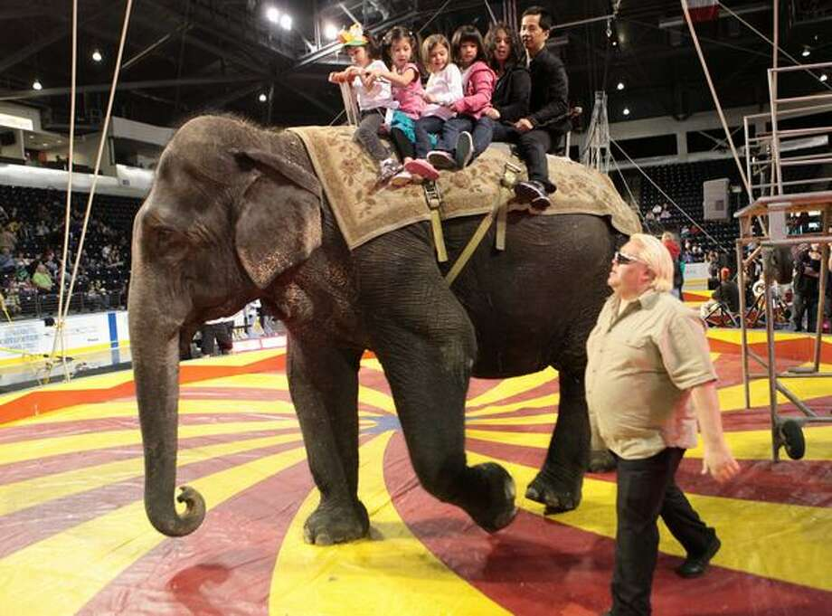 Participants ride on the back of an elephant during the Nile Shrine Circus at the ShoWare Center in Kent. Photo: Joshua Trujillo, Seattlepi.com