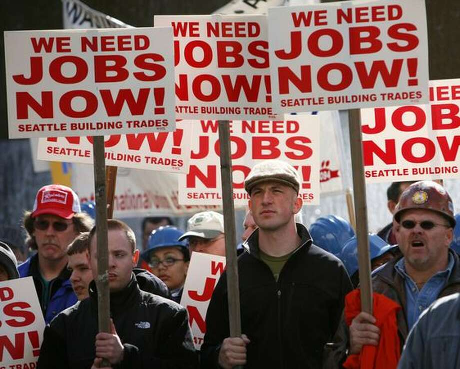 Construction workers and union members gather in Westlake Park for a rally to demand the 520 bridge project, the Viaduct replacement project and a convention center expansion begin. Union leaders said during the rally that jobs the projects would create are  badly needed. Photo: Joshua Trujillo, Seattlepi.com