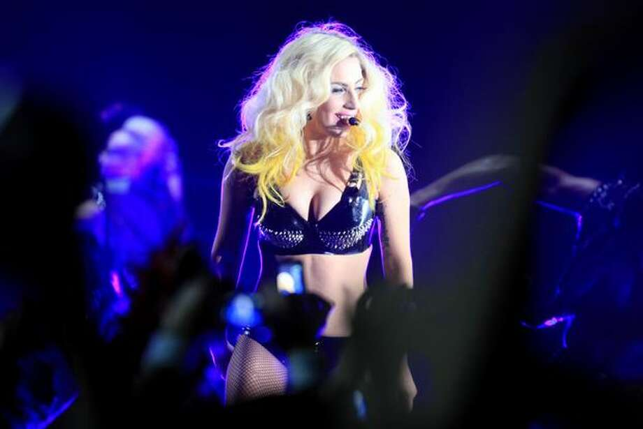 Pop star Lady Gaga performs her song Telephone during a show at the Tacoma Dome. Photo: Joshua Trujillo, Seattlepi.com