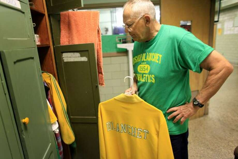 Long-time Bishop Blanchett coach and teacher Bill Herber hangs up his jacket in the locker room at the school in north Seattle. Herber has been a coach, teacher and friend to generations of students that have attended Blanchett. He retired in 2010 after 50 years teaching at the Catholic school. Photo: Joshua Trujillo, Seattlepi.com