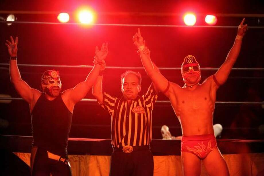 """Chilango"", left, and ""El Bombero"" are declared winners during a performance of Lucha VaVOOM at the Showbox Sodo. Lucha VaVOOM is a combination of Mexican wrestling, burlesque and comedy. Photo: Joshua Trujillo, Seattlepi.com"