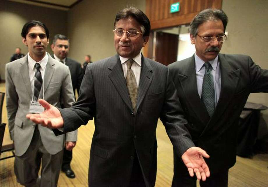 Former President of Pakistan Pervez Musharraf walks into a ballroom at the Bellevue Westin Hotel for a talk and a question and answer session. The former president spoke for almost an hour and took questions from the audience. Photo: Joshua Trujillo, Seattlepi.com