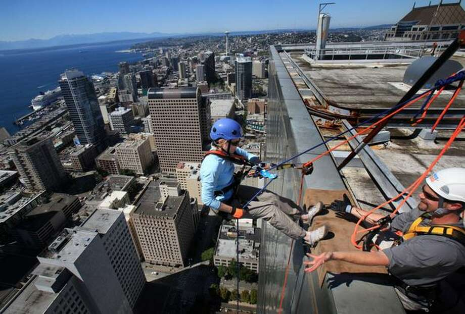 "Kiersta Smith begins to rappel during ""Over the Edge,"" a fundraiser for Special Olympics Washington in downtown Seattle. 112 people were scheduled to rappel off the 40 story Rainier Tower in downtown Seattle during the fundraiser. Most made it, a few struggled with their fear at the top. To earn a spot, rappellers had to raise $1,000 for Special Olympics Washington. Photo: Joshua Trujillo, Seattlepi.com"