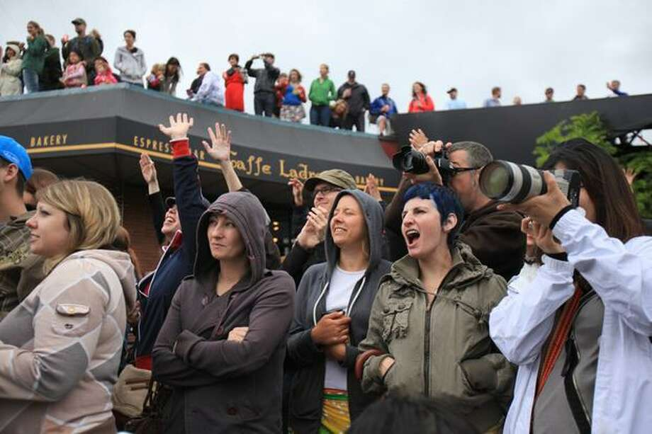 Cameras and cheers greet the beginning of the the Fremont Solstice Parade. Photo: Joshua Trujillo, Seattlepi.com