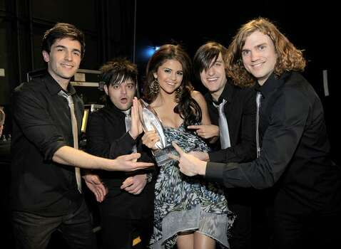 Singer/actress Selena Gomez & the Scene, winners of the Favorite Breakout Artist award, pose backstage. (Photo by Charley Gallay/Getty Images for PCA) *** Local Caption *** Selena Gomez Photo: Getty Images