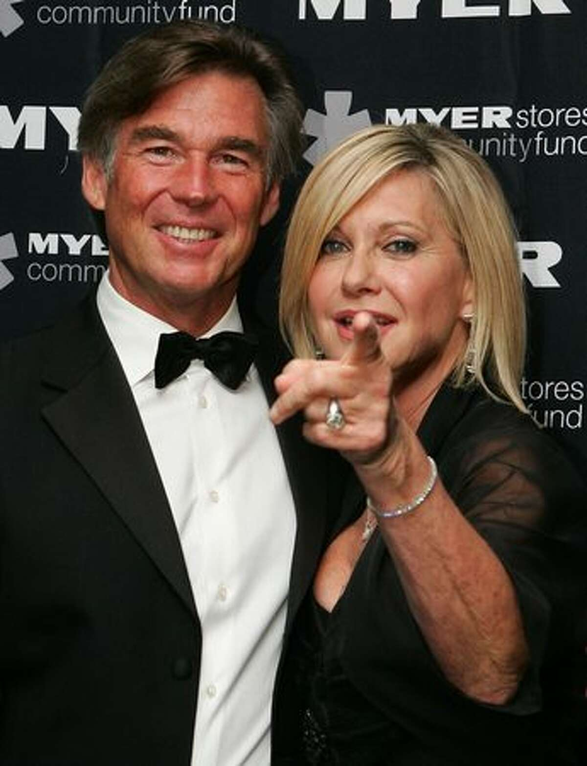 Olivia Newton-John and husband John Easterling arrive at the 2010 Precious Metal Ball in support of the Olivia Newton-John Cancer and Wellness Centre at Peninsula, the Docklands on May 21, 2010 in Melbourne, Australia.
