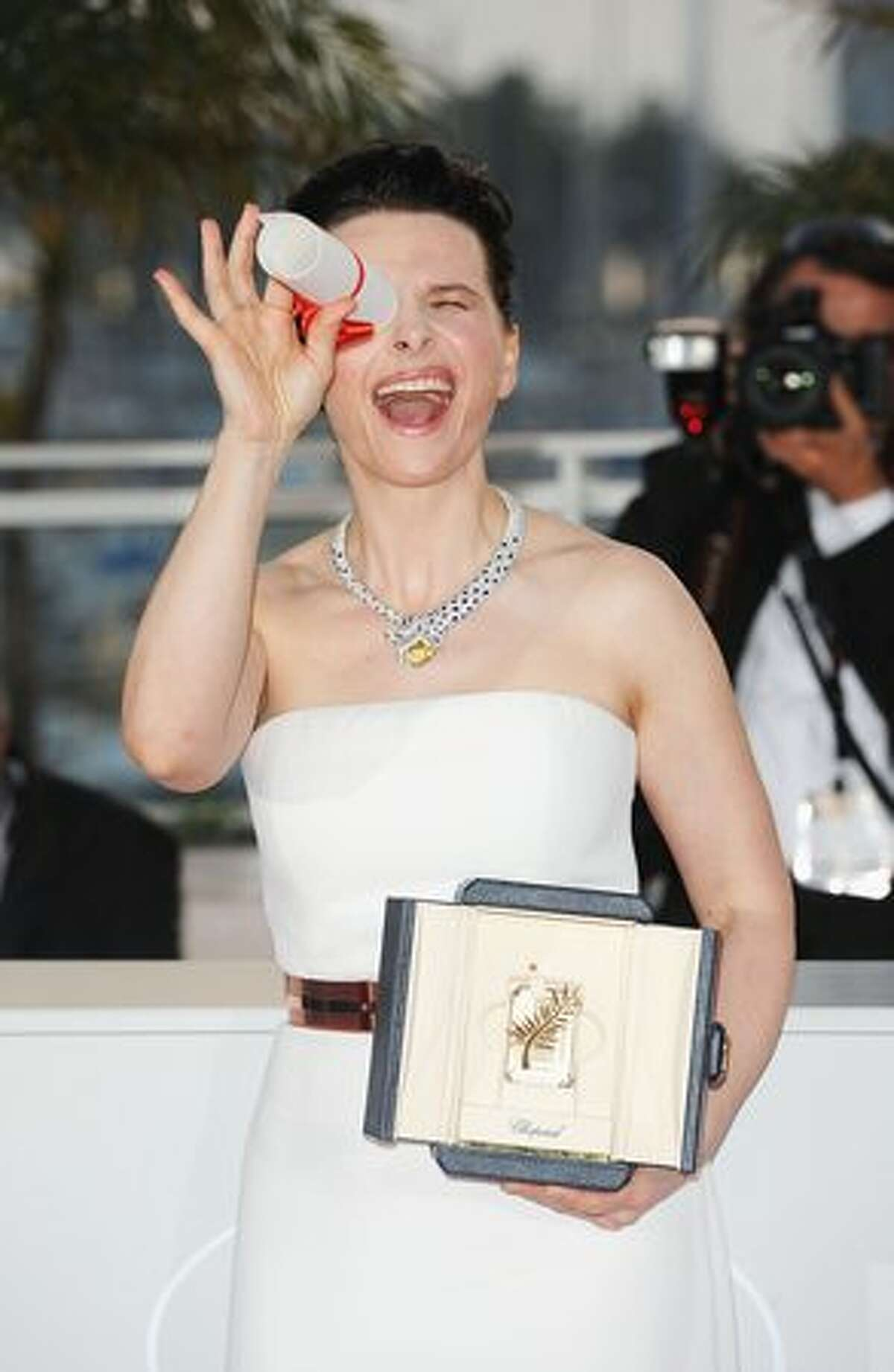 Actress Juliette Binoche poses with her Best Actress award for her role in