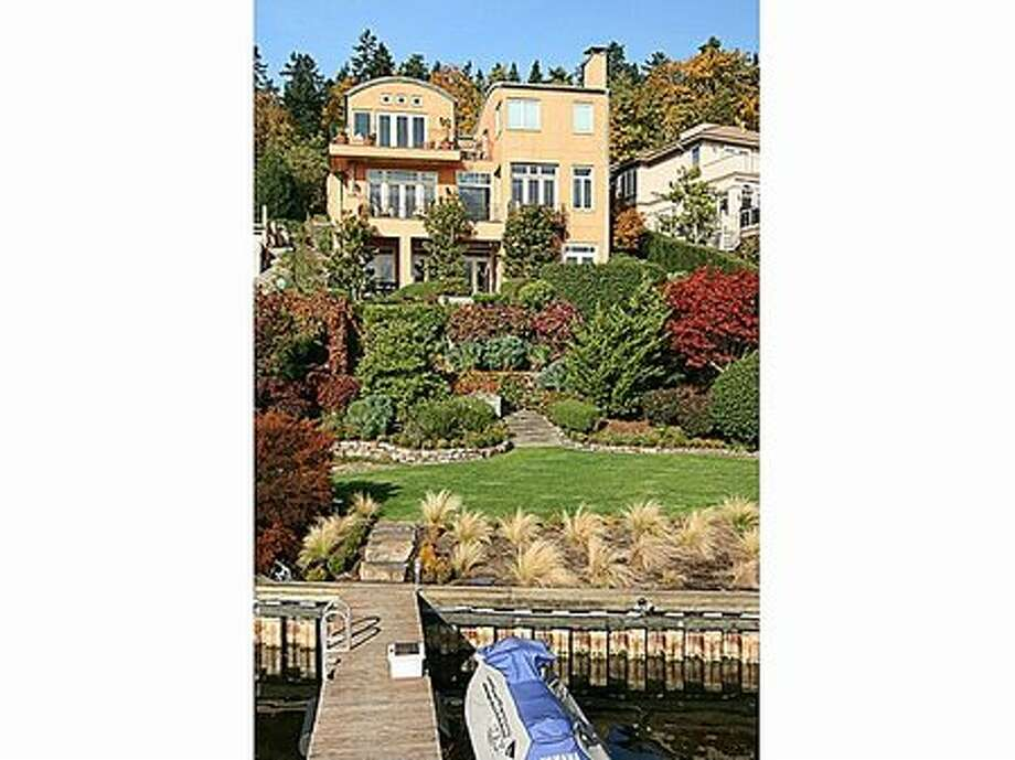 8020 Avalon Place, Mercer Island. Sold for $3.07 million on April 15. Five bedrooms, 4.5 bathrooms, 6,620 square feet on a 13,068-square-foot lot. Features 62 feet of waterfront next to the Mercer Island Beach Club and Clark Beach. More Photo: Zillow.com