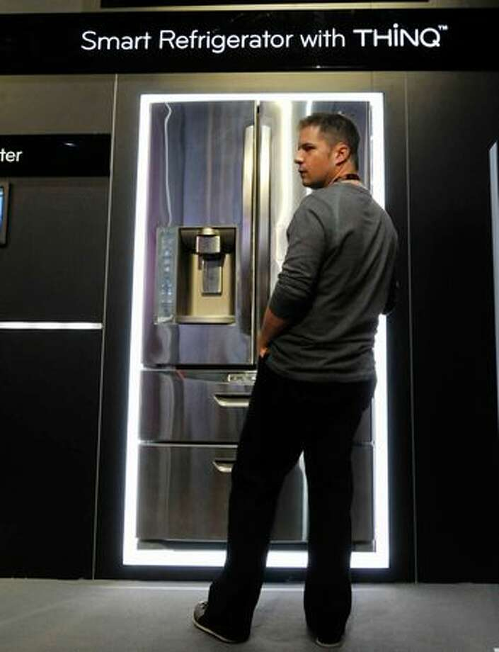 An attendee examines the LG Smart Refrigerator on Jan. 6 at the 2011 International Consumer Electronics Show in Las Vegas. Photo: Getty Images