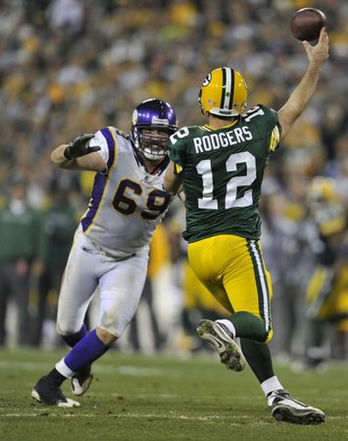 No. 7: Green Bay Packers quarterback Aaron Rodgers, shown here throwing a pass as Minnesota Viking Jared Allen bears down on him on October 24, 2010 at Lambeau Field, in Green Bay, Wisc.