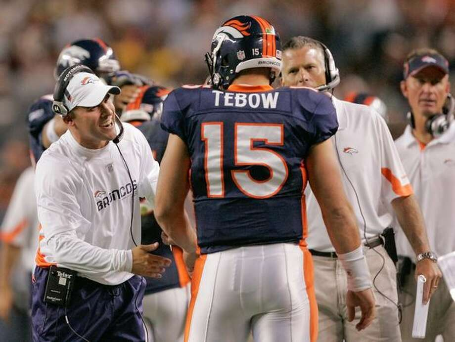 No. 3: Rookie Denver Broncos quarterback Tim Tebow, shown here talking with since-fired head coach Josh McDaniels against the Pittsburgh Steelers on Aug. 29, 2010 at INVESCO Field at Mile High, in Denver. Photo: Getty Images